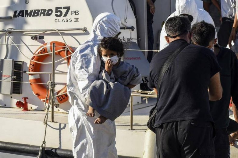 Searching for missing migrants after their boat sank off Crete
